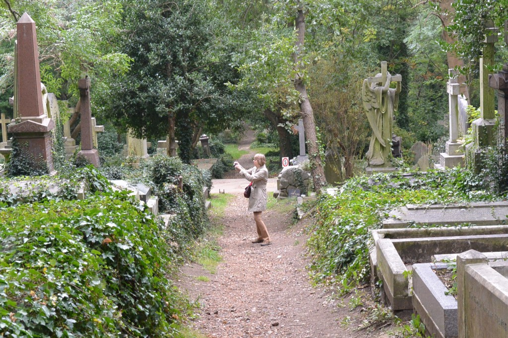 Nina taking pictures of the dead places.